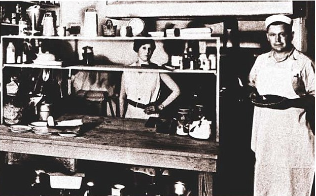 A young Sanders cooking fried chicken in Sanders Court and Café, Kentucky. (1932)