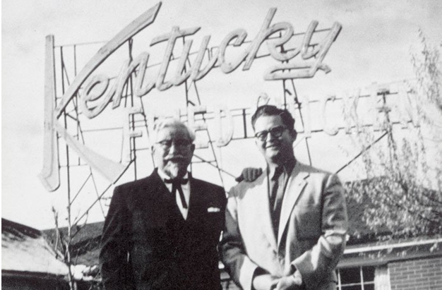 Sanders with Pete Harman, owner of the first KFC franchise, in Salt Lake City, Utah. (1952)