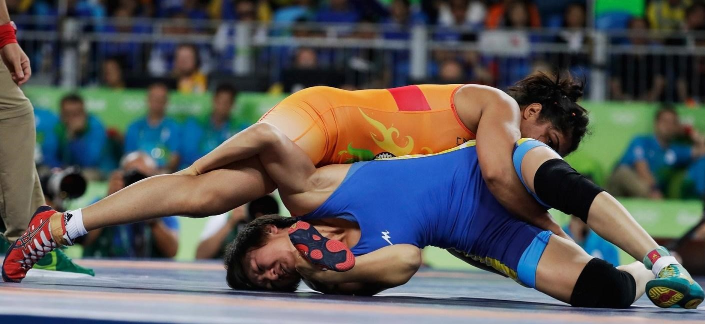 Sakshi Malik (in orange) moments before winning the Bronze medal at 2016 Rio Olympics for Wrestling