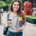 Smiling Student Walking Outdoors